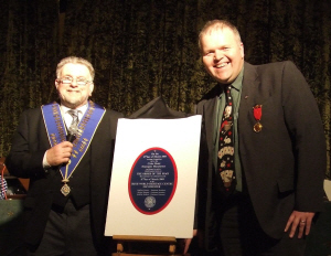 Geoff and Mike unveil the Centenary Plaque